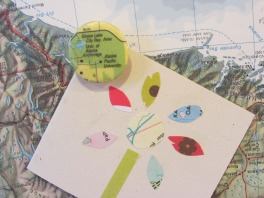 button tacks covered with vintage maps