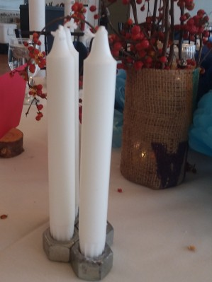 giant hex nuts make a dramatic candlestick holder